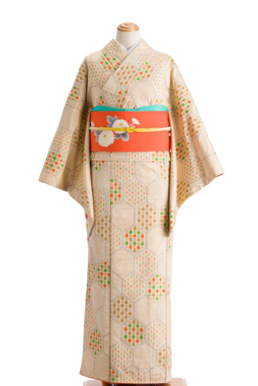 「紬 亀甲にグリーンやオレンジのドット」の商品画像
