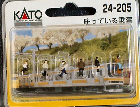 人形 座っている 乗客