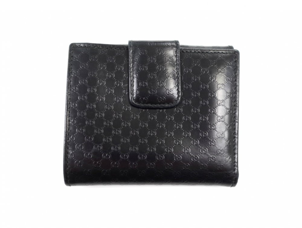 GUCCI  グッチ シグネイチャー柄 二つ折り財布 MADE IN ITALY USED