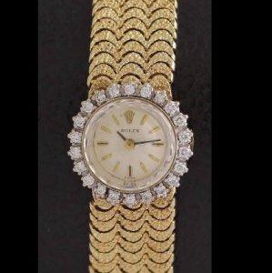 ロレックス レディースアンティーク腕時計 ゴールドのブレスに、花が咲いたように見えるケース