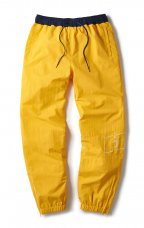 <img class='new_mark_img1' src='//img.shop-pro.jp/img/new/icons5.gif' style='border:none;display:inline;margin:0px;padding:0px;width:auto;' />NYLON TRACK PANT - YELLOW