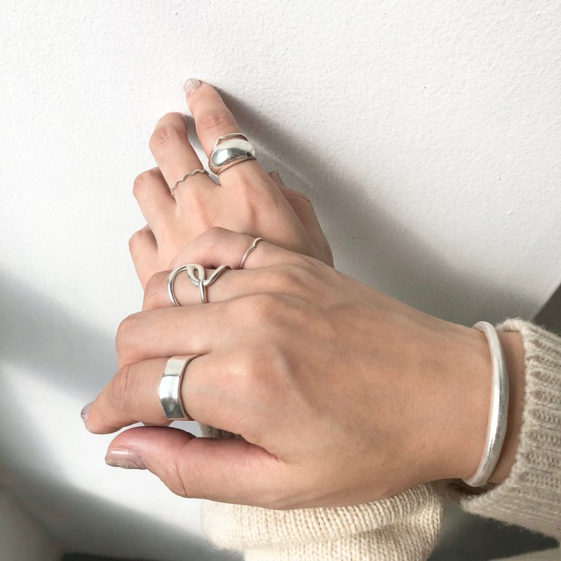 embrace hand ring