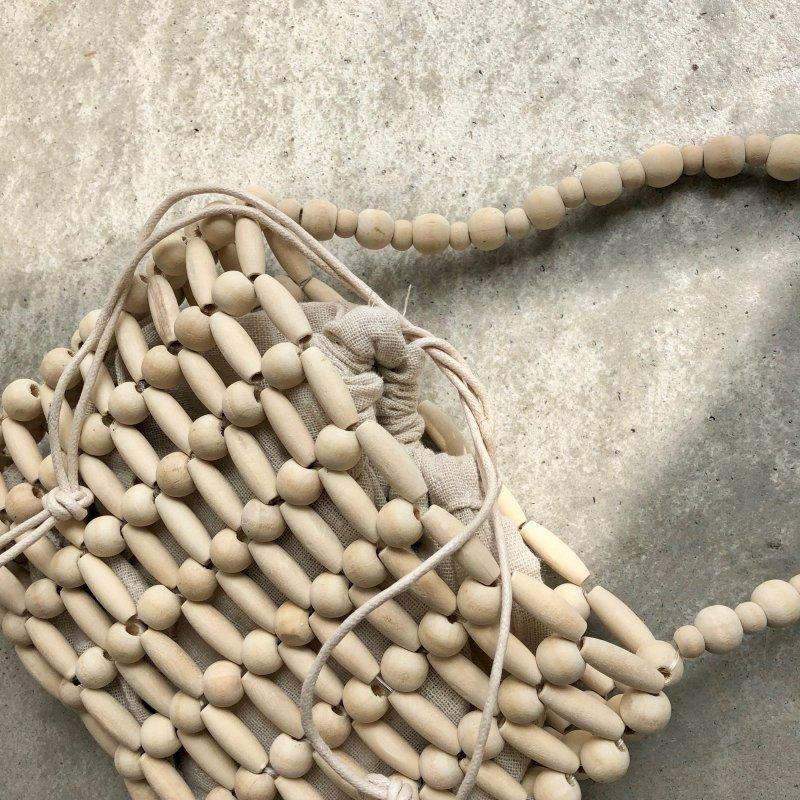 cotton purse in bundle ball wood bag