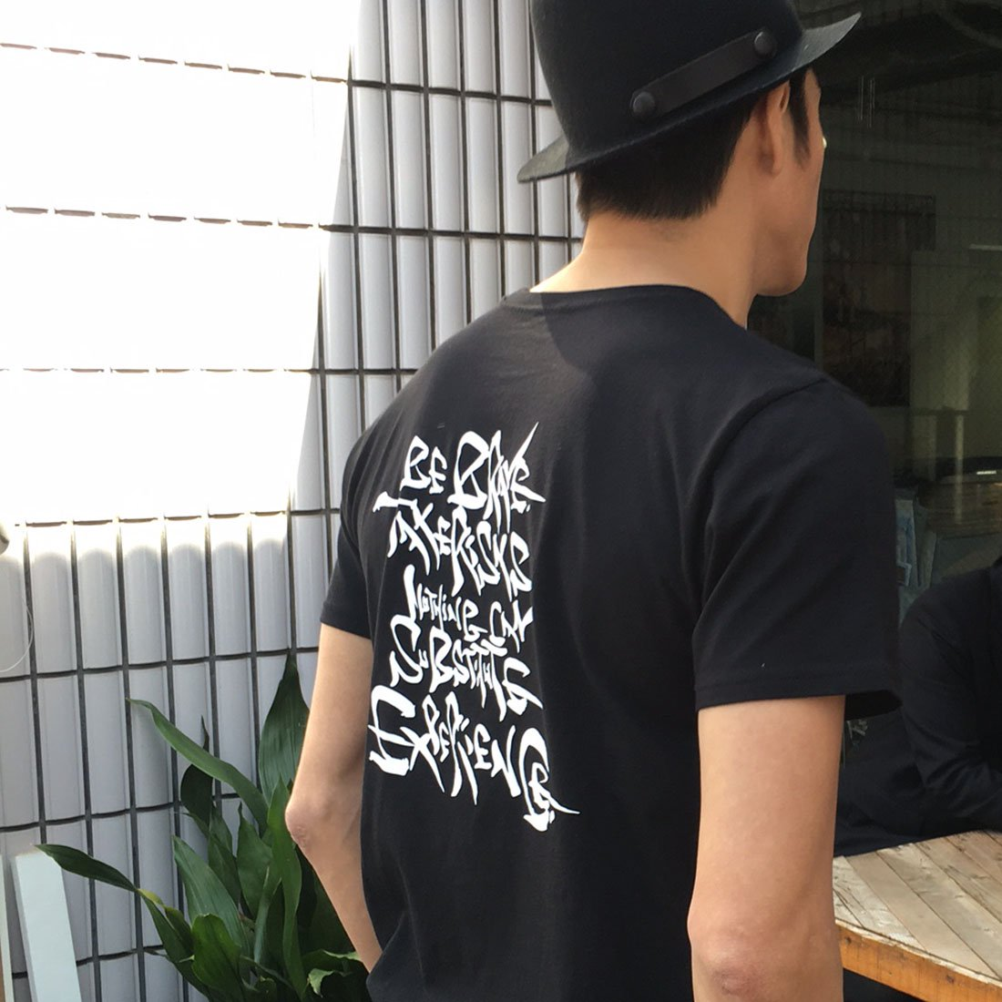 【REBIRTH PROJECT】「BE BRAVE...」Tシャツ by 伊勢谷友介