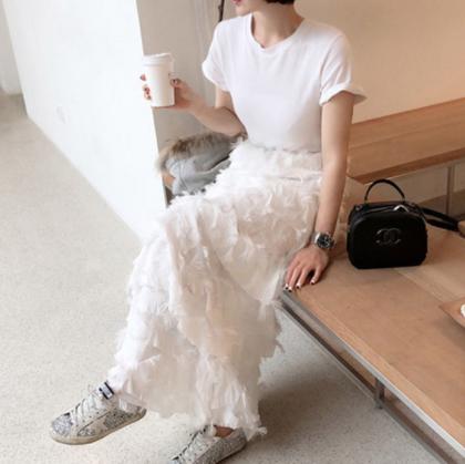 ティアードスカートのフェザーがおしゃれで個性的 セパレート風半袖ワンピース 2色