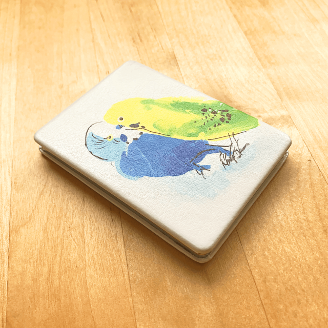 折りたたみミラー(オクムラミチヨ / 2羽のセキセイインコ) 商品の様子